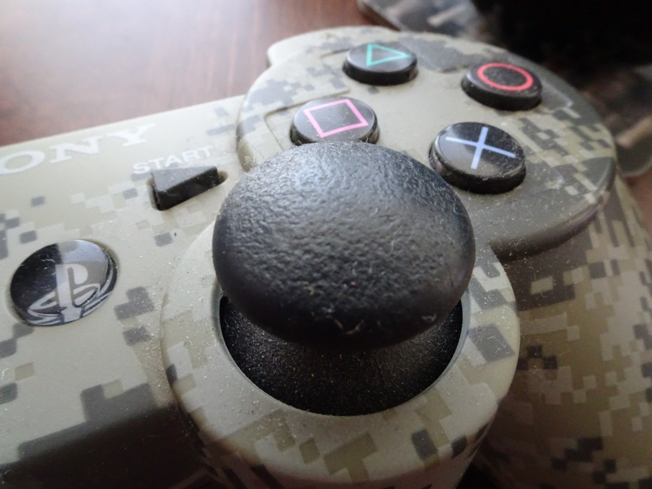Cleaning the sticky PlayStation controller analogue thumb sticks